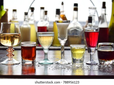 Selection of alcoholic drinks. Set of wine, brandy, liqueur, tincture, cognac, whiskey in glasses, bottles. Large variety of alcohol and spirits for making cocktails and drink. Copy space for text