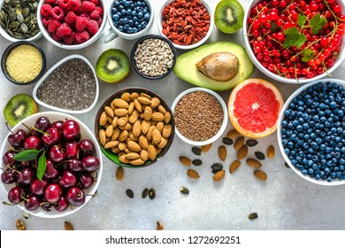 Selection of antioxidant food. Healthy super foods, detoxification with fruits and various berries. Fresh nourishment on table