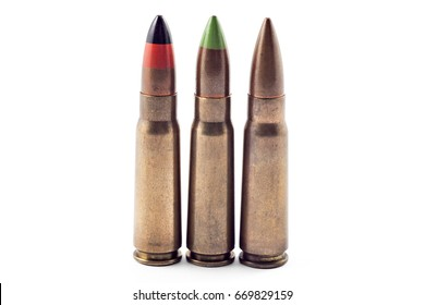 A selection of army bullets for kalashnikov, isolated on white. Bullets of different types: tracer, armor piercing...