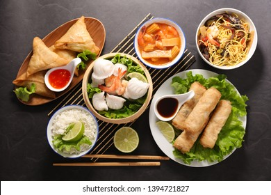 selection of asian meal with spring roll, samosa, fried noodles, soup