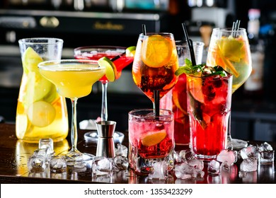 Selection of best selling cocktails martini spritz mojito in bar blurred background, Cocktail El Diablo and Cosmopolitan on bar counter alcohol collection bartender liqueur