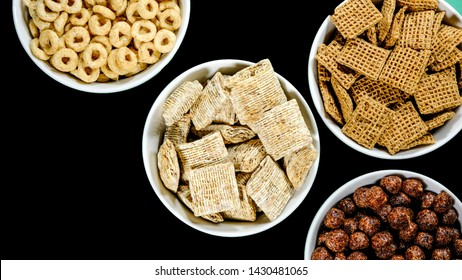 Selection of Bowls of Healthy Eating Breakfast Cereal Including Shredded Wheat Chocolate Nesquik Shreddies and Cheerios