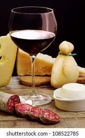 selection of cheese and salami with  red wine