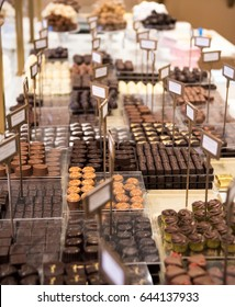 Selection of chocolate in a row, shop in Belgium.