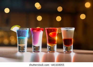Selection of cocktail drinks. Blurred background.