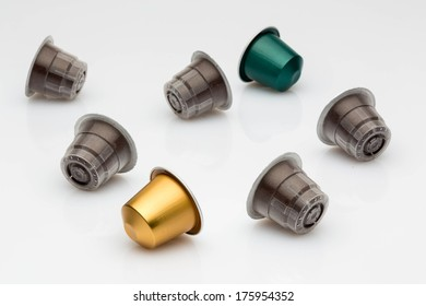 A selection of coffee blends, in disposable coffee capsules, on a white background.