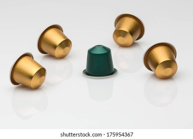 A selection of coffee blends, from strong to weak, in disposable coffee capsules, on a white background with a lot of whitespace.
