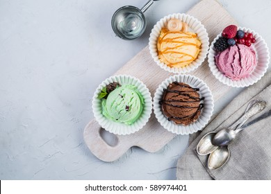 Selection of colorful ice cream scoops, copy space
