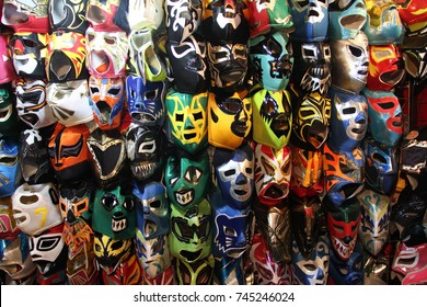 "A selection of colorful ""Lucha Libre"" Mexican professional wrestling masks, for sale outside of Arena Mexico, Mexico City"