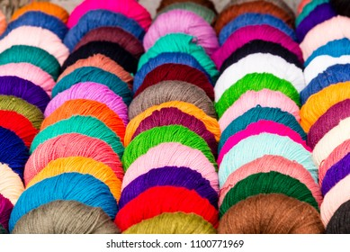 A selection of coloured yarn for sale at a shop in India.