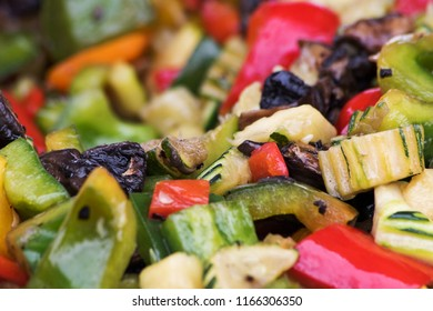 A selection of cooked roasted vegetables peppers mushrooms