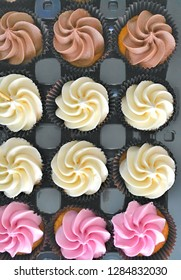 A selection of cupcakes with frosted buttercream icing
