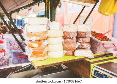 selection of delicious handmade traditional cheese for sale at farmers food market