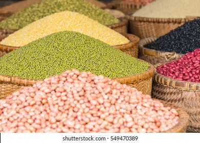 Selection of different peeled peas and beans on a market on heaps in baskets in Hanoi, Vietnam