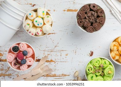 Selection of different rolled ice creams in cone cups