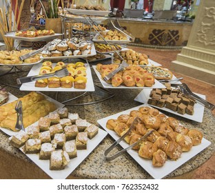 Selection display of sweet pastry dessert food at a luxury restaurant buffet bar area