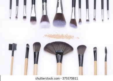 selection focus brushes for professional makeup artist on white background