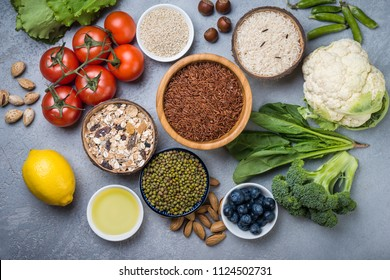Selection of  food for health, cereals, nuts, fruits, vegetables and greens. Flat lay
