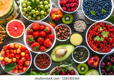 Selection of food. Healthy superfood, detox antioxidant diet with fruits and assorted berries. Fresh nutrition on table. Breakfast in a bowls with different ingredients.