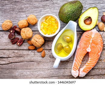 Selection food sources of omega 3 and unsaturated fats. Super foods high vitamin e and dietary fiber for healthy food on wooden background.