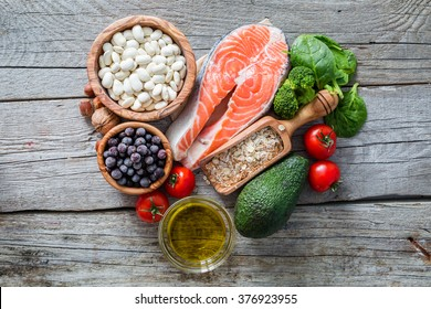 Selection of food that is good for the heart, rustic wood background