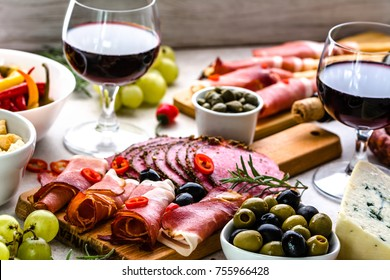 Selection of food, wine snack set on table, italian antipasti, prosciutto, salami, olives, cheese and other appetizer on platter