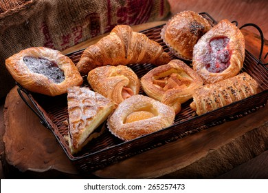Selection of French & Danish pastries on a Wicker basket