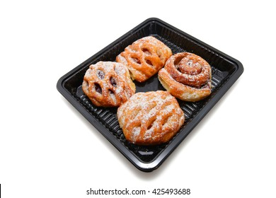 Selection of French & Danish pastries in a tray from the supermarket isolated on white background