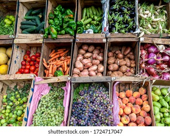 A selection of fresh fruit and vegetables packed in crates for sale on the roadside in the mountain town of Imlil in Morocco..