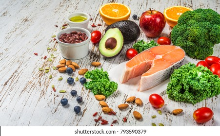 Selection of fresh fruit and vegetables, salmon, grains, and nuts. Concept of cooking and eating healthy food, fitness, dieting, vegetarian, and lifestyle. Ingredients good for heart and diabetes