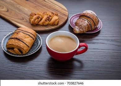 Selection of fresh sweet pastries and morning coffee.