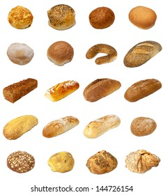 A selection of freshly baked bread and baps isolated on a white background.