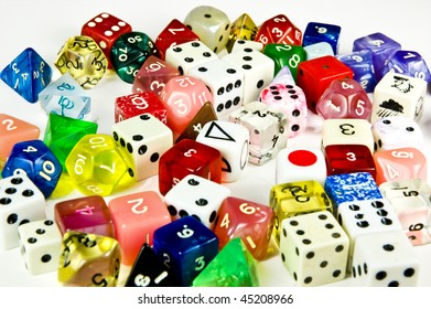 A selection of gaming dice of various shapes and colors.