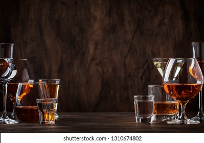 Selection of hard strong alcoholic drinks big glasses and shot glass in assortent: vodka, cognac, tequila, brandy and whiskey, grappa, liqueur, vermouth, tincture, rum.