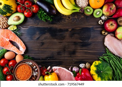 Selection of healthy food. Fresh organic vegetables, fruits, meat and fish. Healthy eating and healthy life concept. Top view, copy space