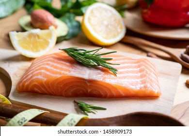 Selection of healthy food for heart on wooden background.