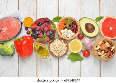 Selection of healthy food on white background. Healthy diet foods for heart, cholesterol and diabetes. Top view.