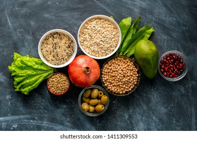 selection of healthy superfood on the chalkboard surface with fruit cereals and herbs