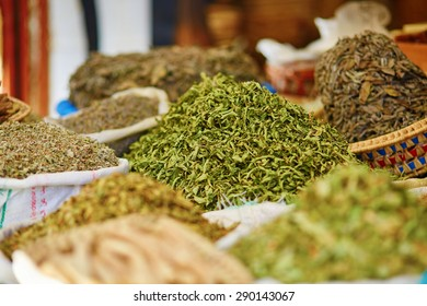Selection of herbs on a traditional Moroccan market (souk) in Fes, Morocco
