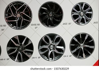 Selection of Honda car wheels in Geneva International Motor Show (GIMS), Geneva Switzerland March 2019. White wall with multiple wheels in it. Beautiful display. Color image.