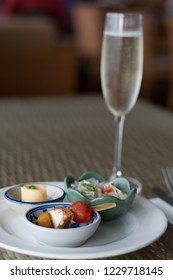 selection hot and cold hor d'oeurves with sparkling champagne