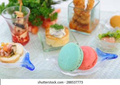 A selection of canap�©s including macarons and vol-au-vents.