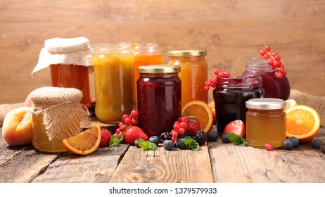 selection of jam on wood background