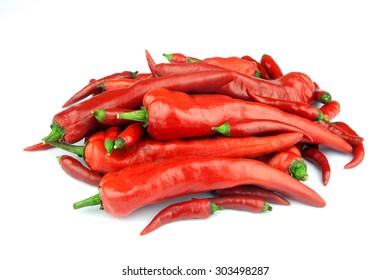 A selection of large and small fiery red chilli peppers isolated on a white background