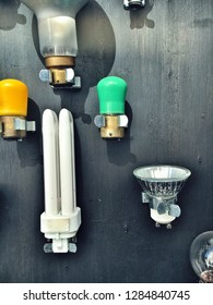 A selection of lightbulbs on a wooden background