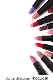 A selection of lipstick colors laid flat to form a page border, isolated on a white background