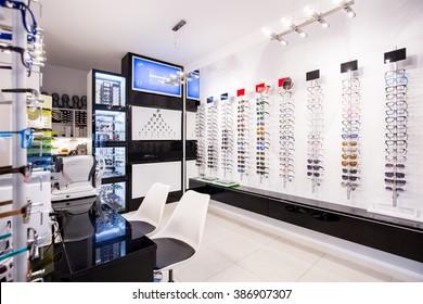 Selection of modern eyeglasses rims at optician's store