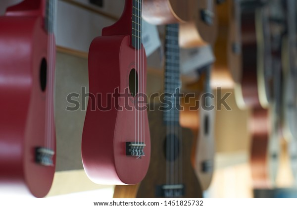 A selection of new ukeleles on display - focus is on a red soprano uke