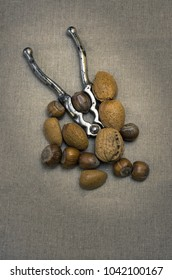 Selection of Nuts on a Hessian Background with a vintage Nut Cracker