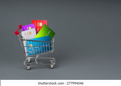 A selection off credit cards,bank cards and store cards in a shopping Trolley